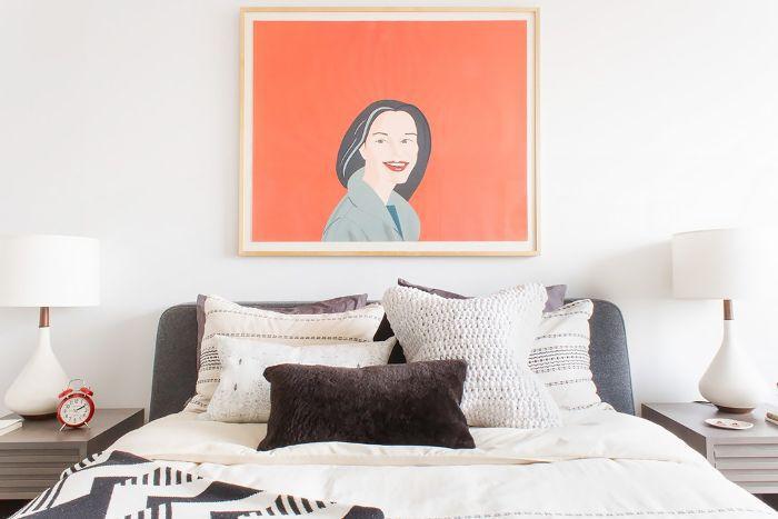 Framed print over bed