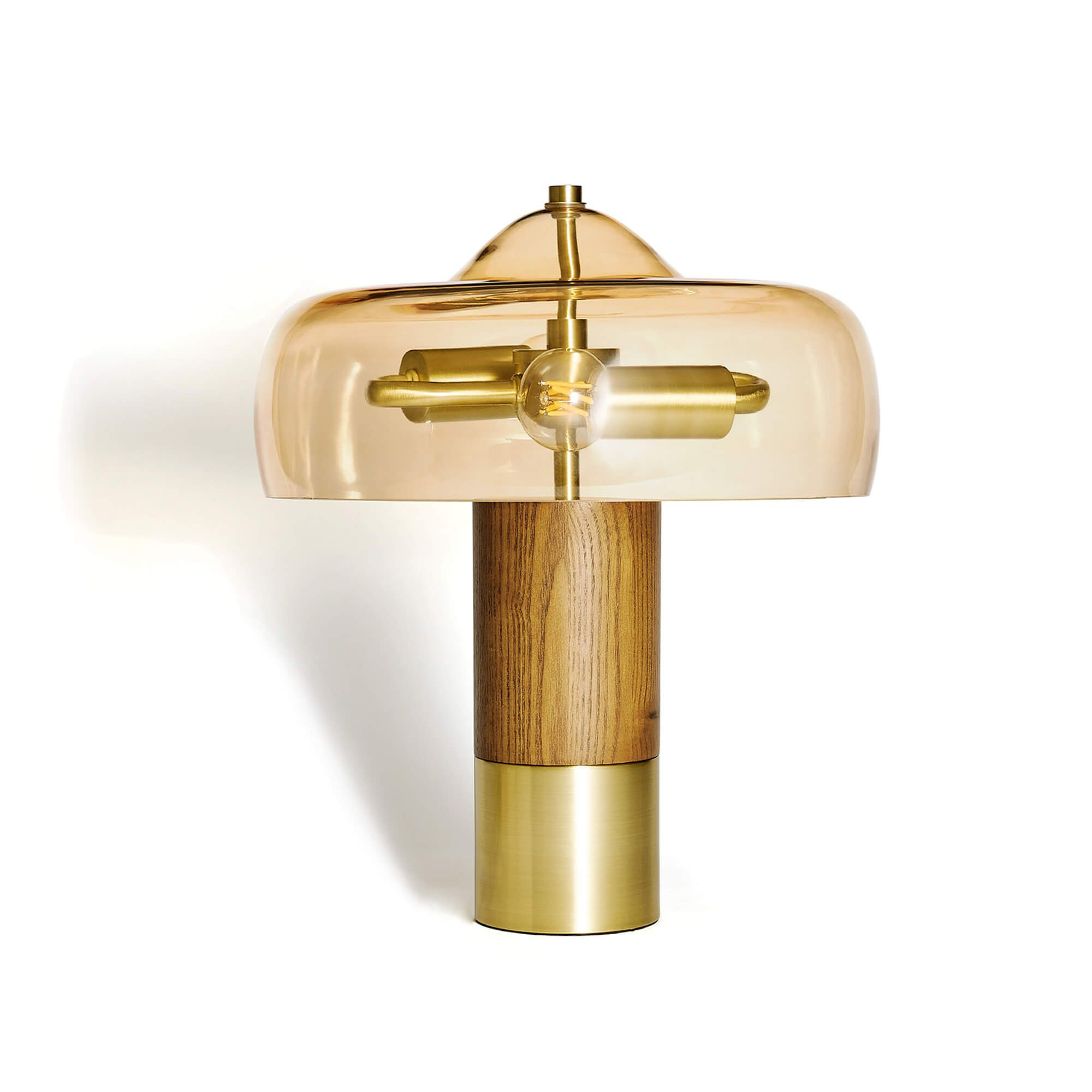 A midcentury style table lamp with a smoked glass shade, Edison bulb, and wood base.