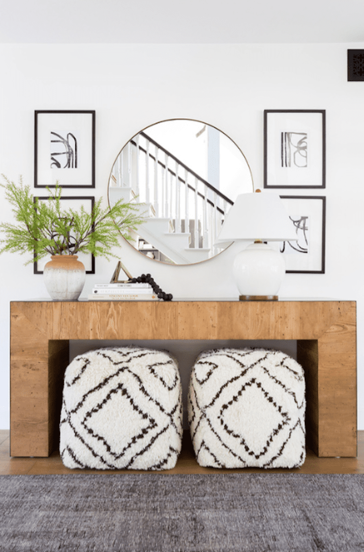 Entryway with shearling ottomons.