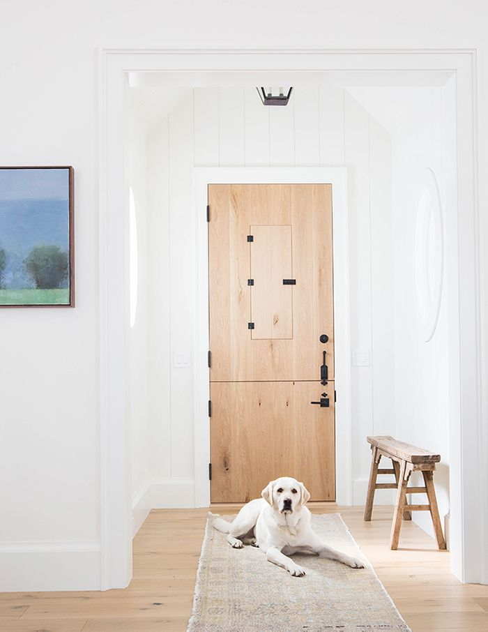 Entryway features a runner and a golden retriever in front of doorway