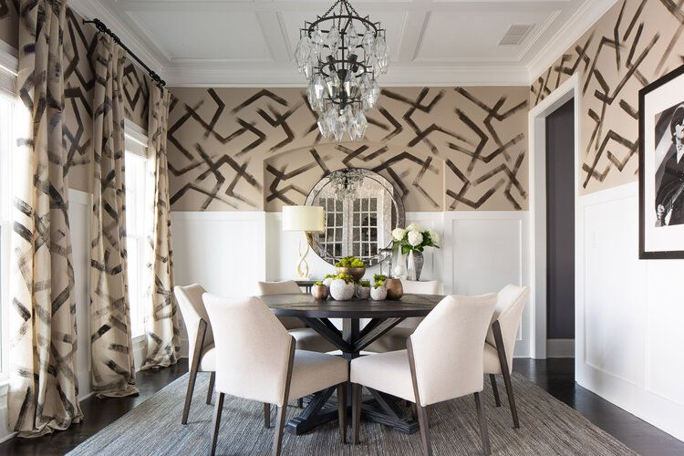 Dark brown and tan dining room with hand-painted geometric patterned walls and matching drapes