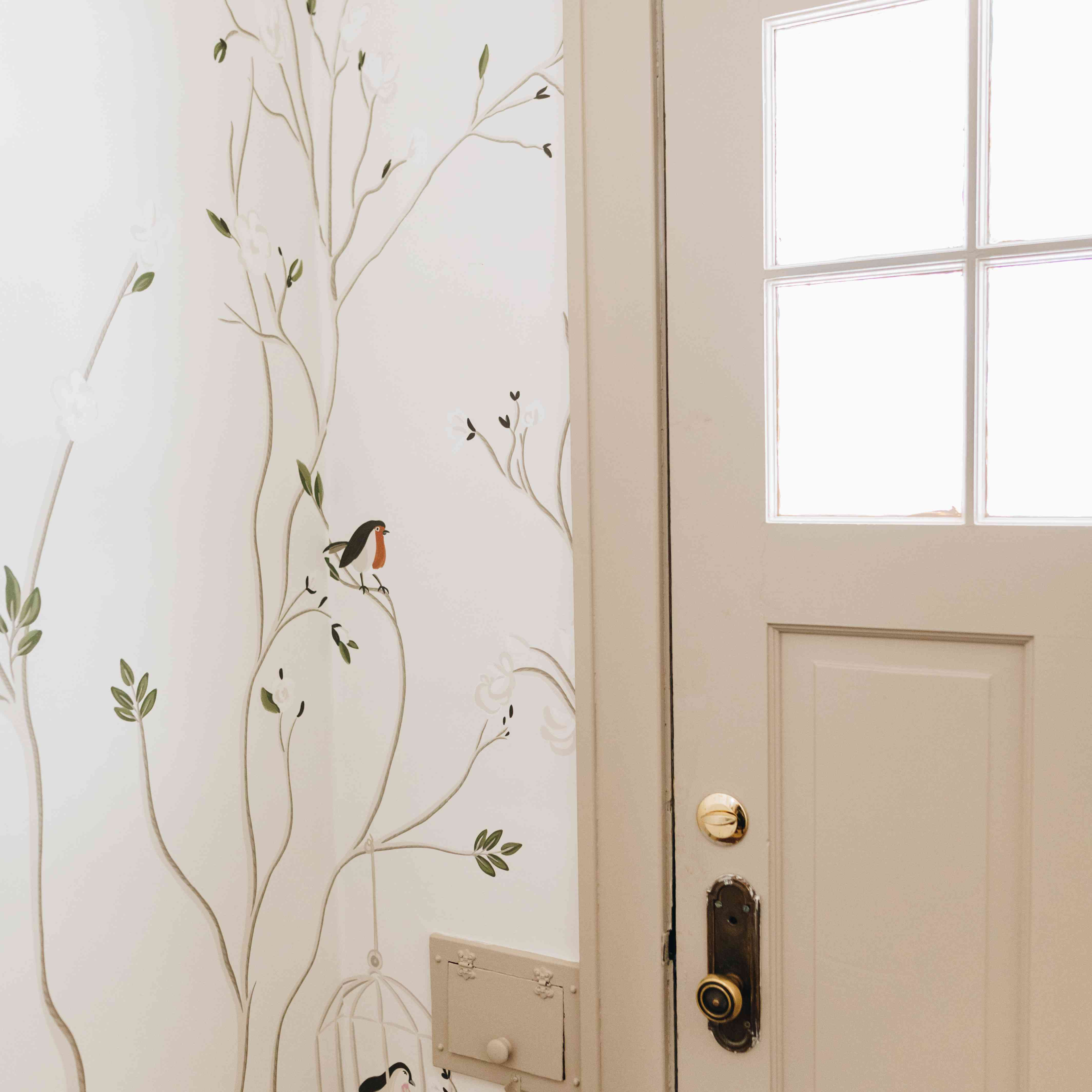 Entryway with hand-painted wallpaper by She She