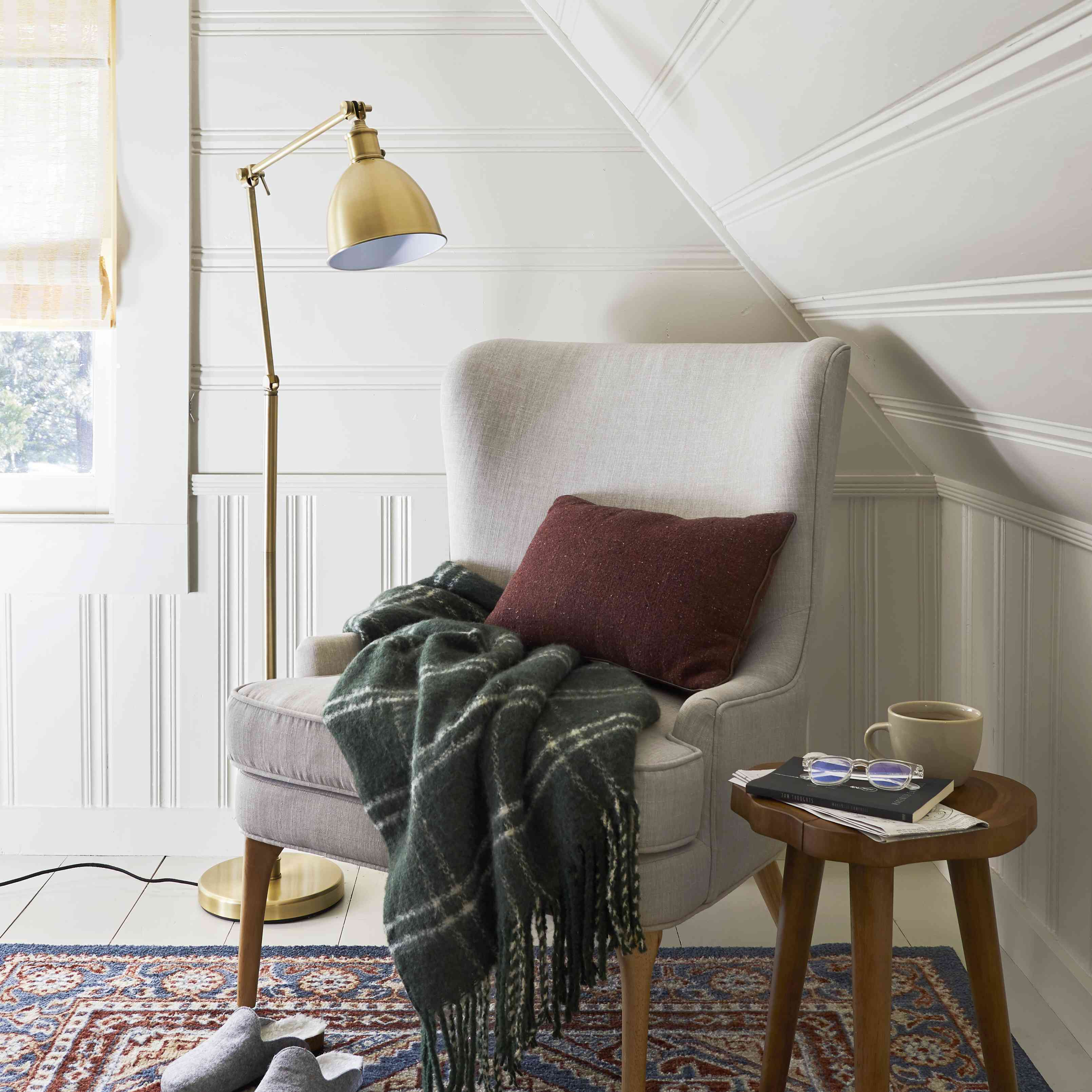 Reading nook with white painted wood paneling