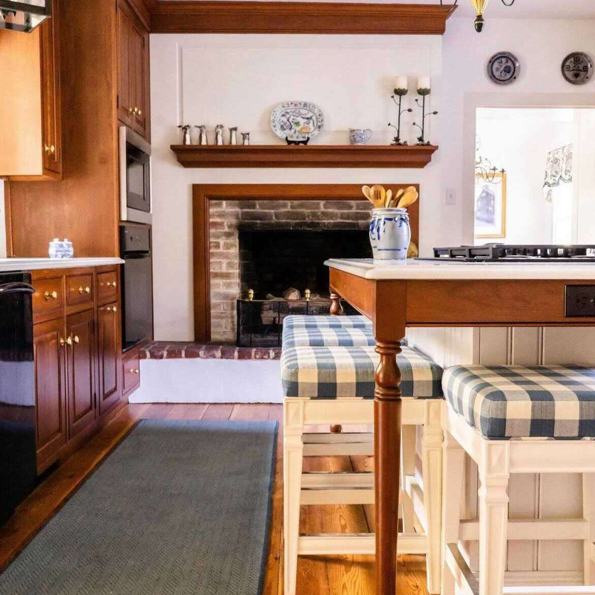 Traditional wood kitchen with blue gingham kitchen island stools