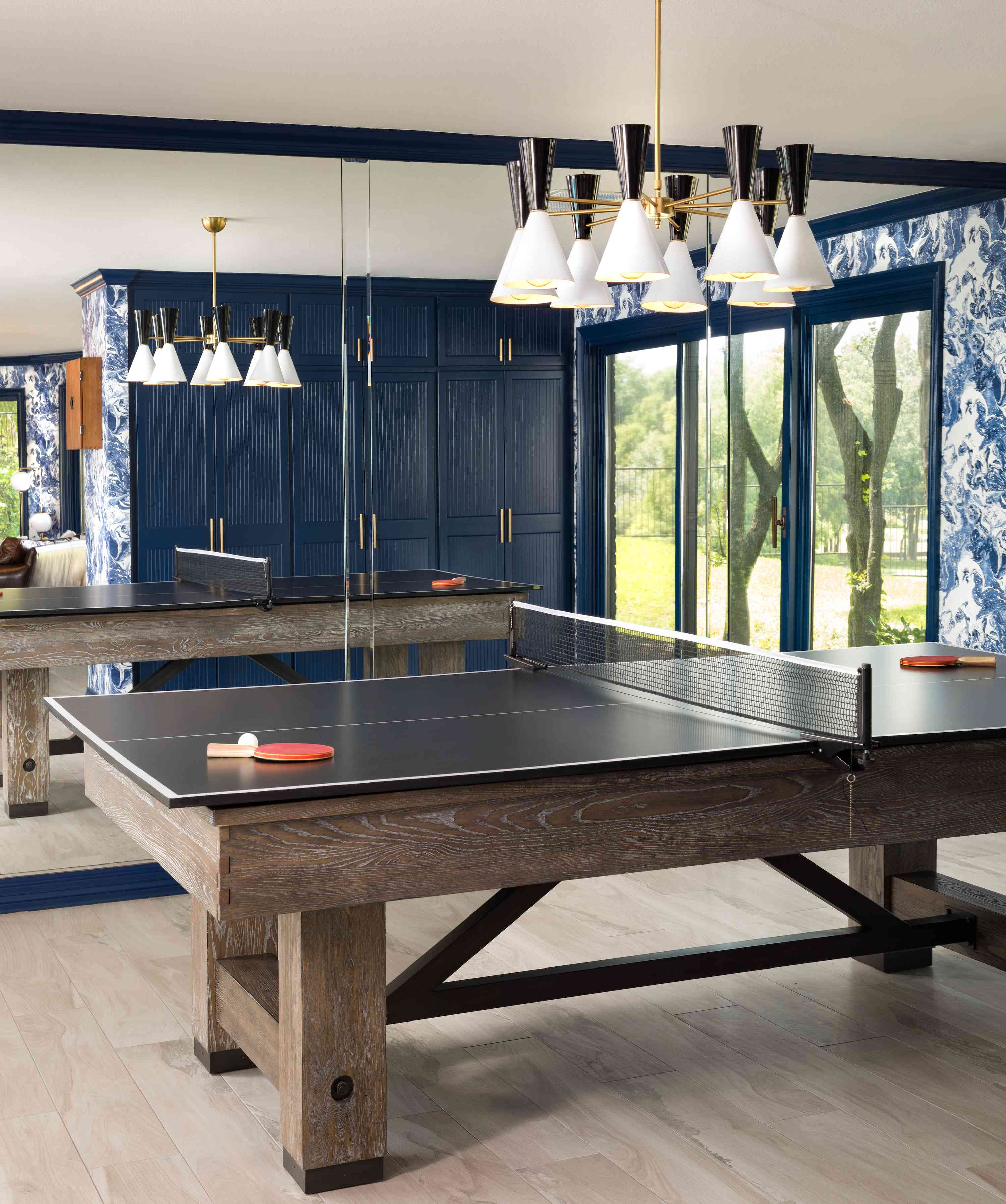 Ping pong table in middle of room.