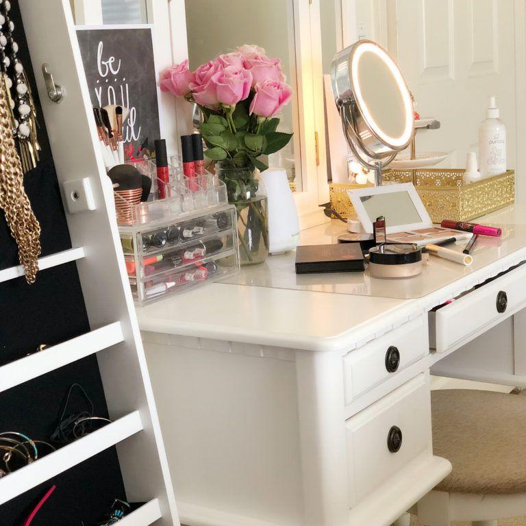 White vanity setup with illuminating mirror.