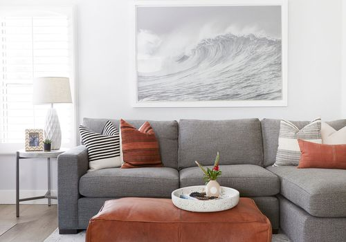 Beachy living room with gray sofa.