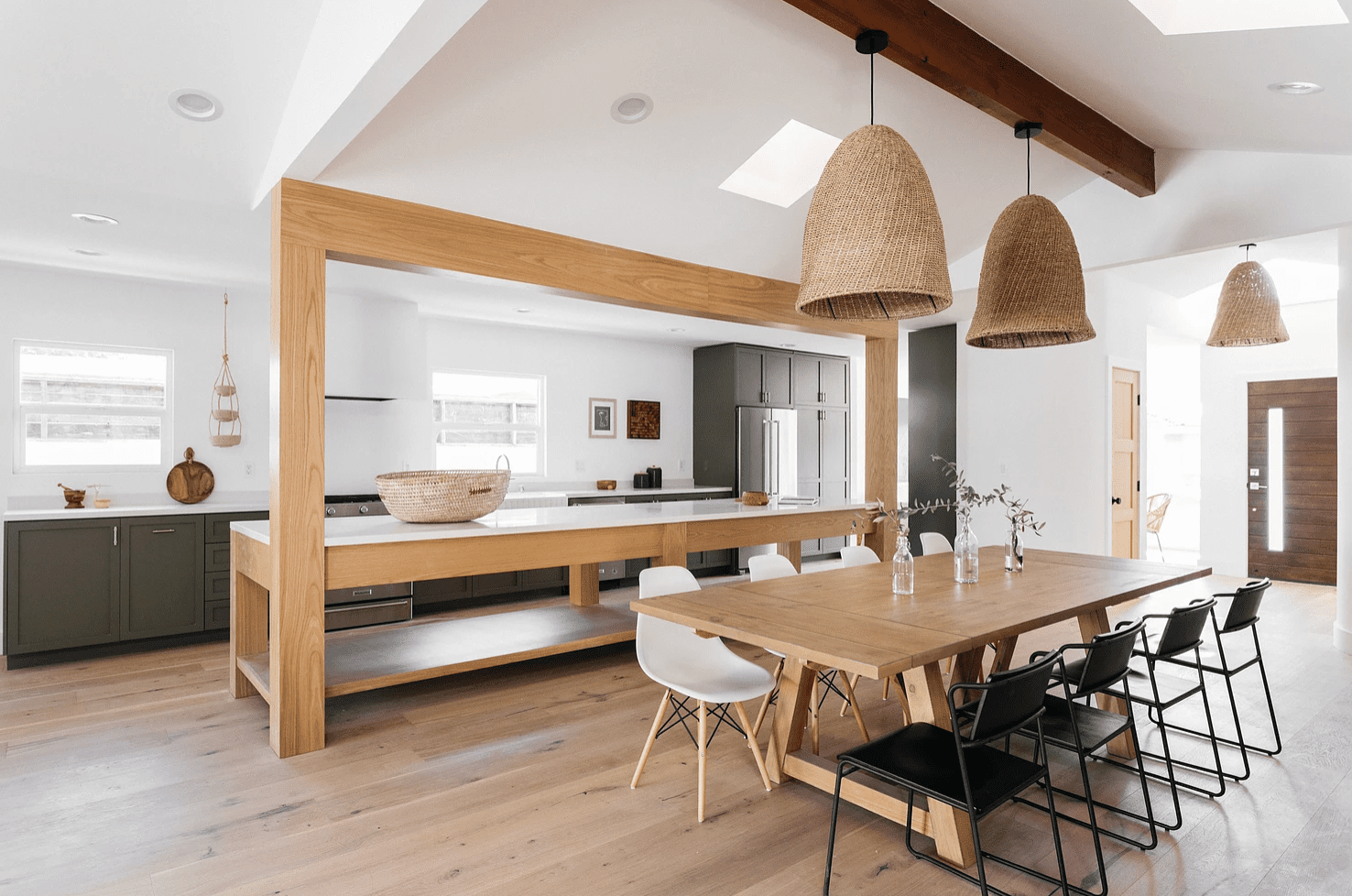 An open-concept kitchen with a wood panel-lined bar
