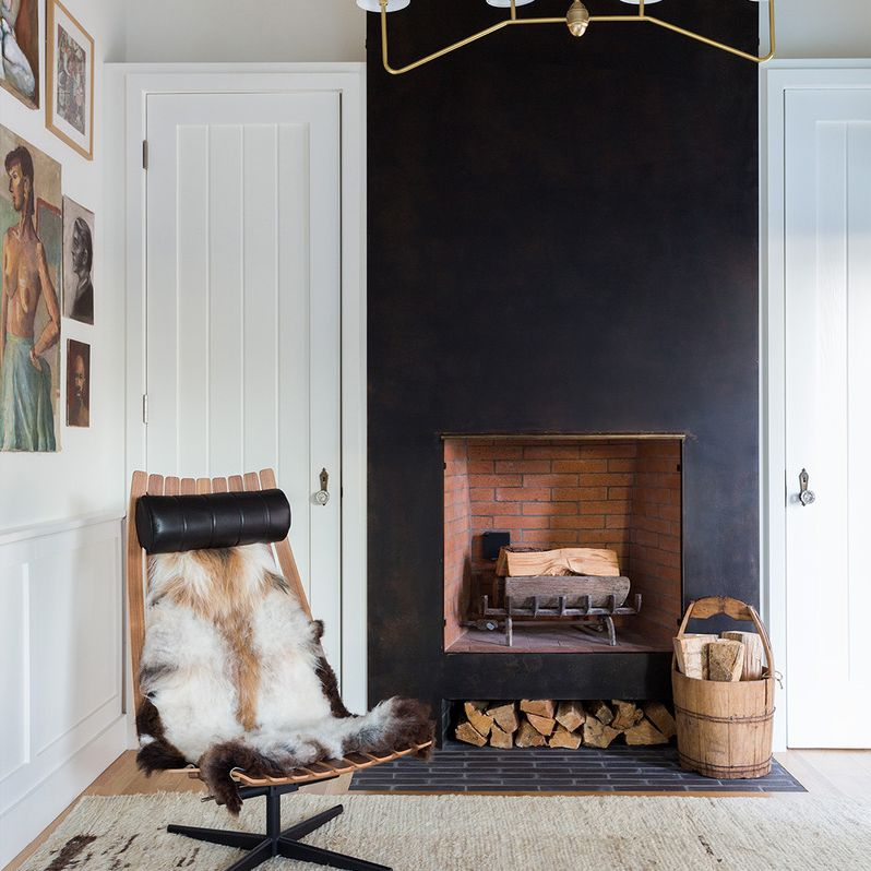Scandinavian rustic living room with pitch black fireplace feature wall