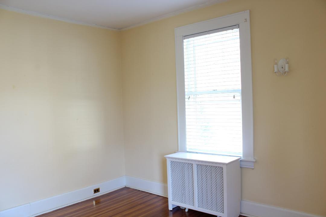 An empty children's bedroom painted yellow.
