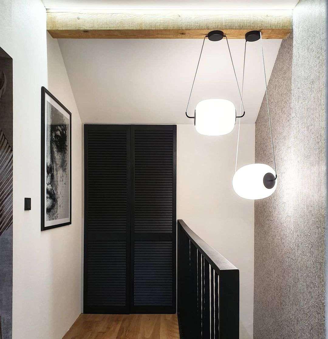 Black textured closet doors.