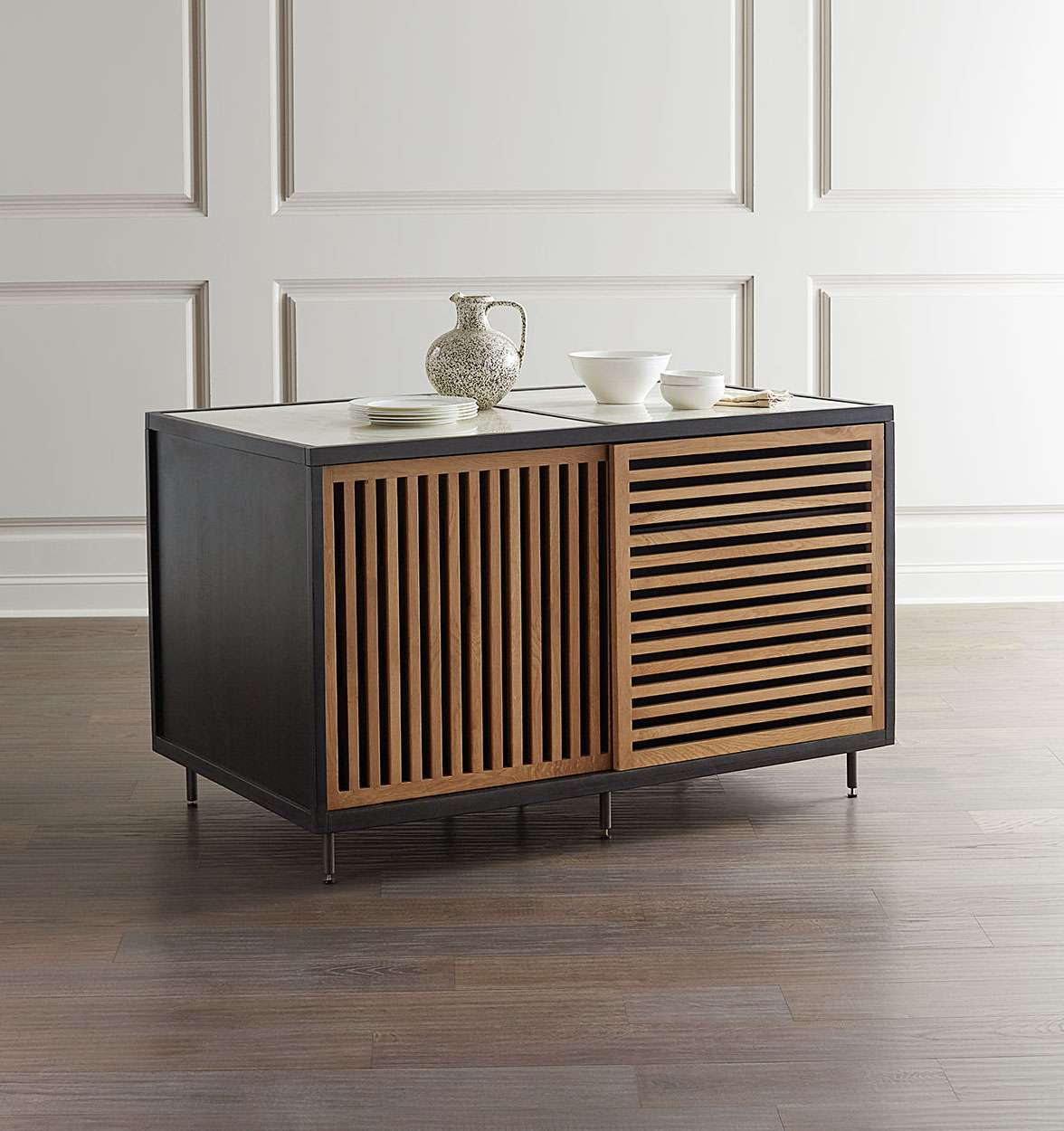 A portable kitchen island lined with discreet shelves