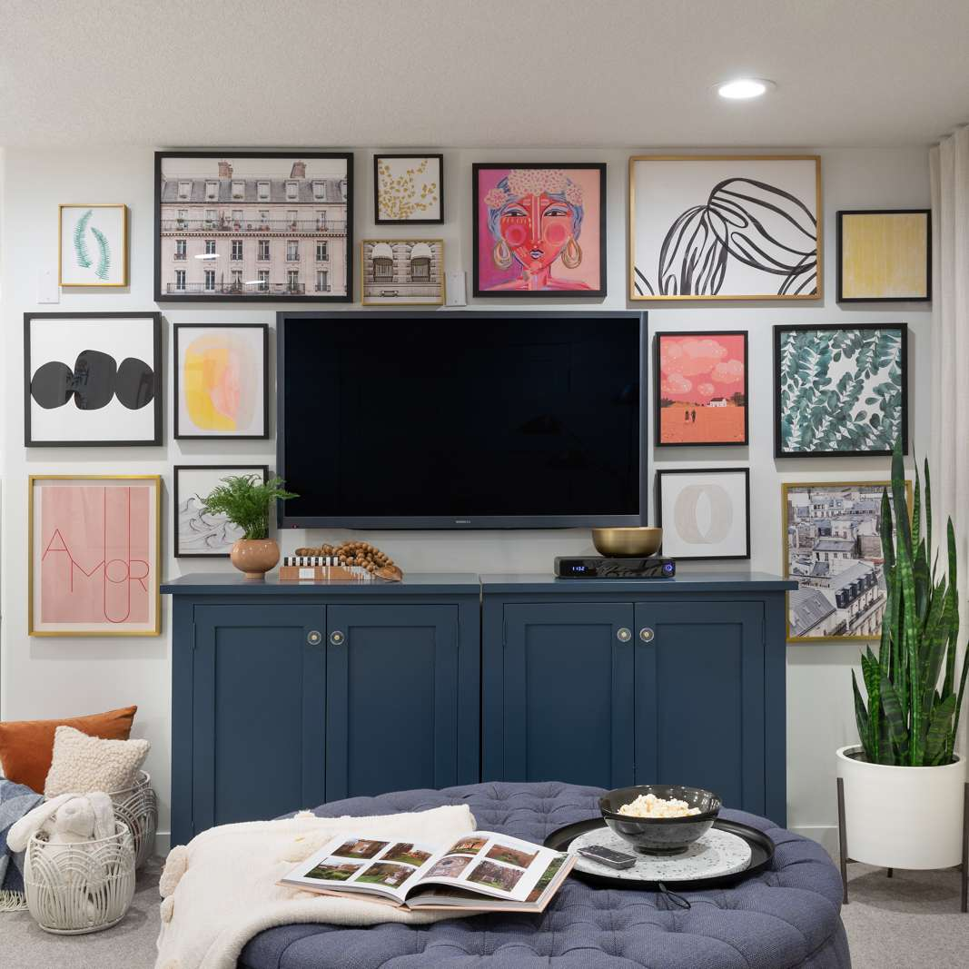 Basement family room with cozy blankets and a colorful gallery wall