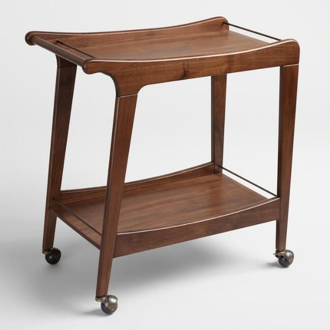 A wooden bar cart on casters in the midcentury style.