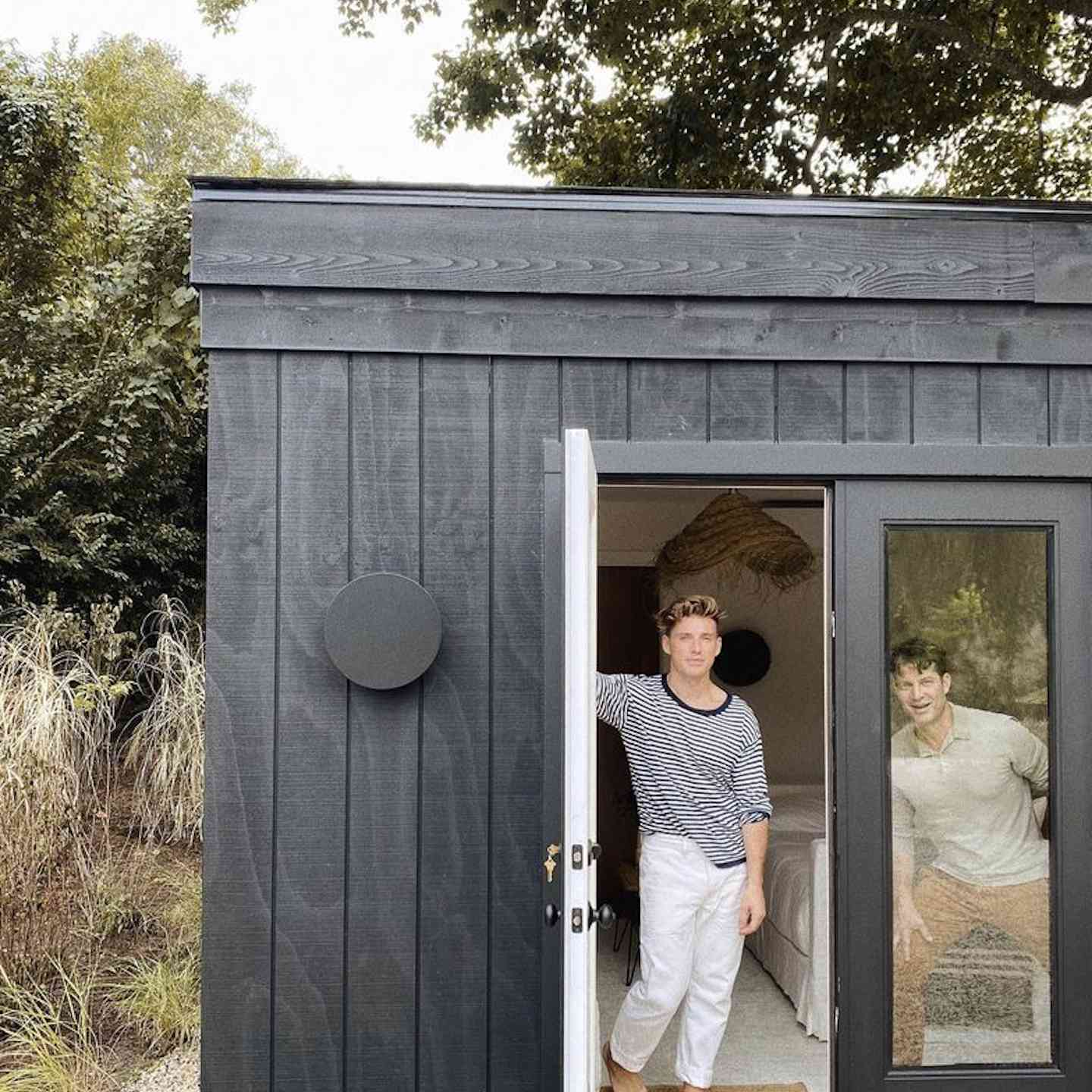 Nate Berkus and Jeremiah Brent in outdoor shed.