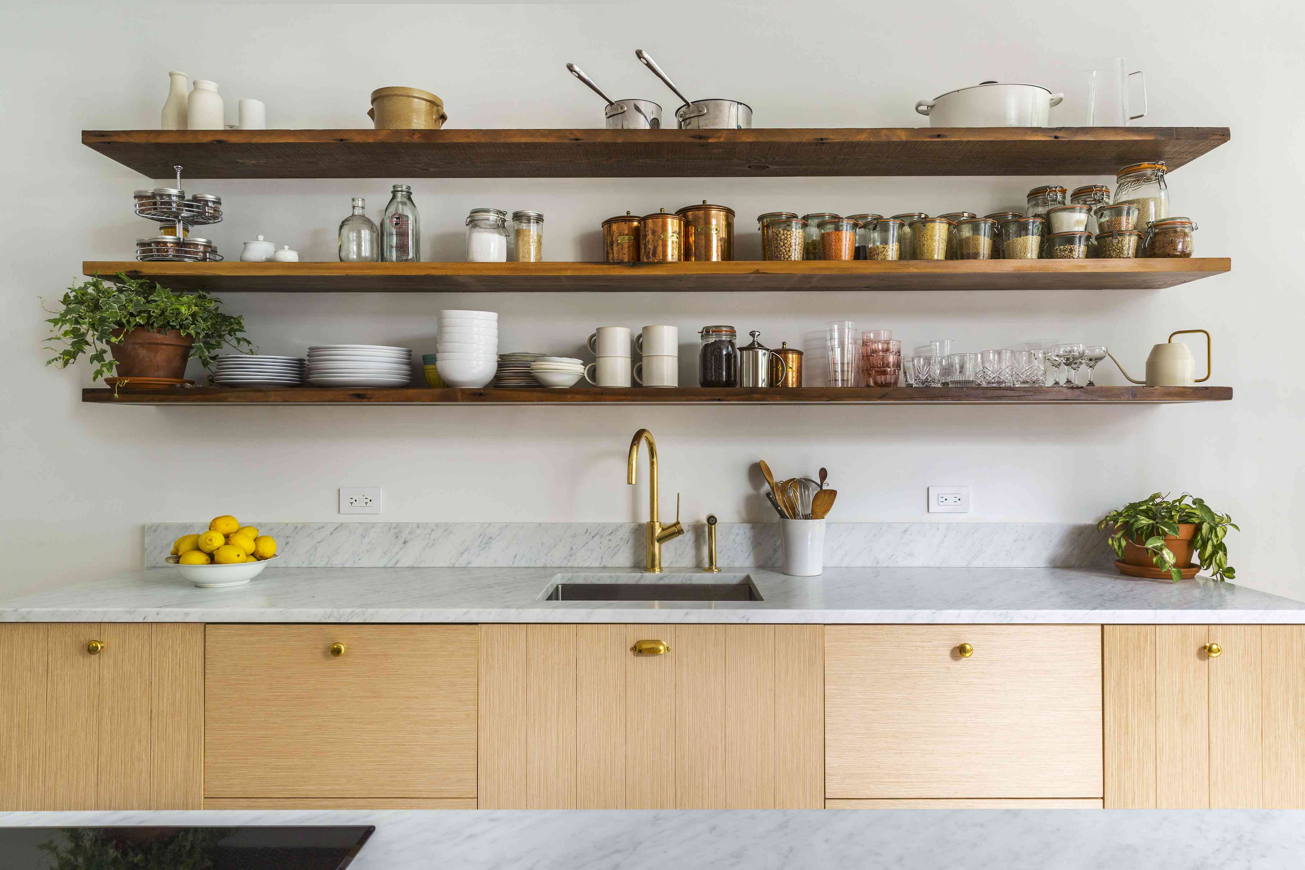 Kitchen with large open shelving units.