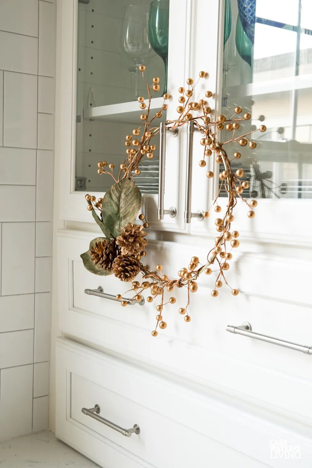 A gold wreath hanging on a cabinet