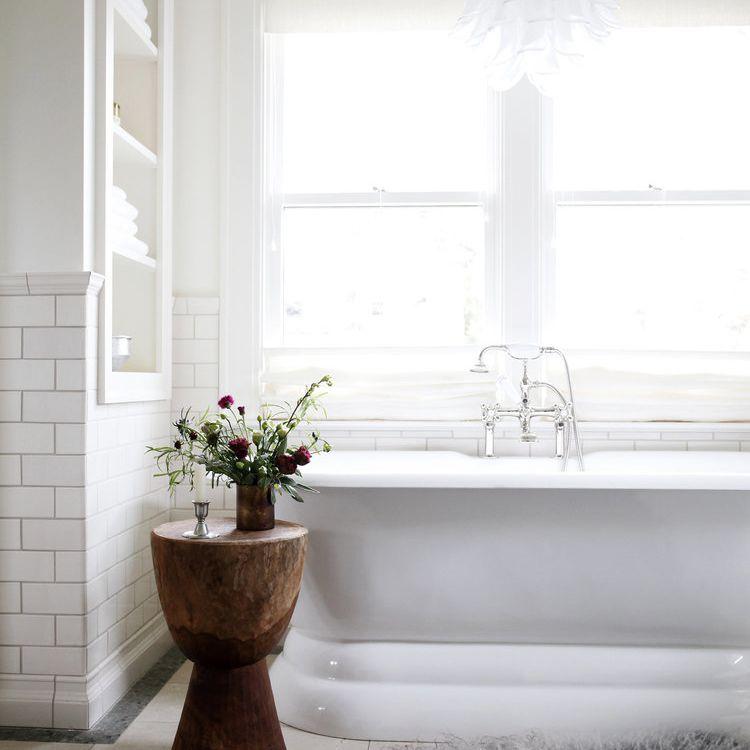 A white bathroom with a fluffy math mat