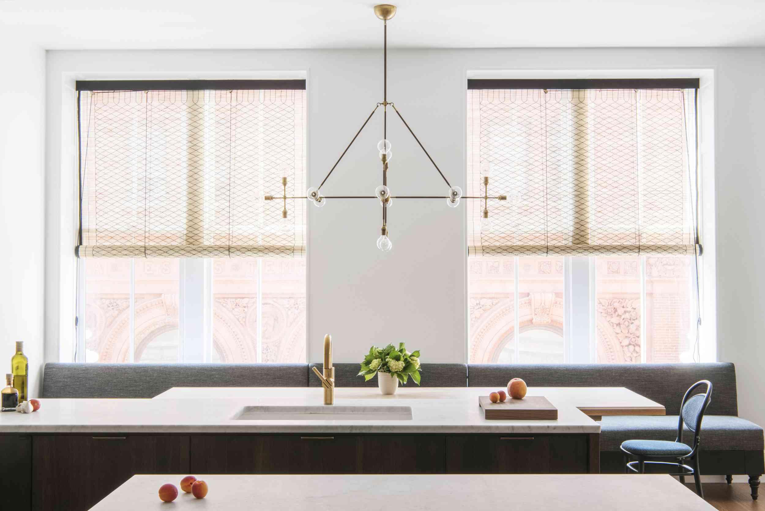 Minimalist kitchen with statement chandelier
