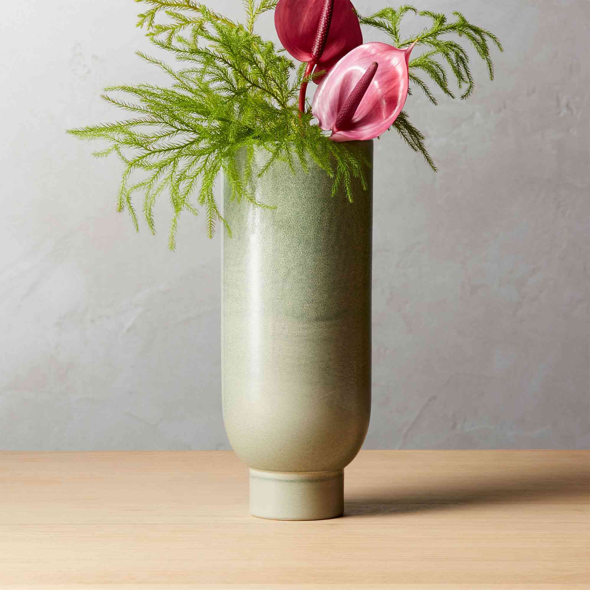 A green tall earthenware vase by CB2.