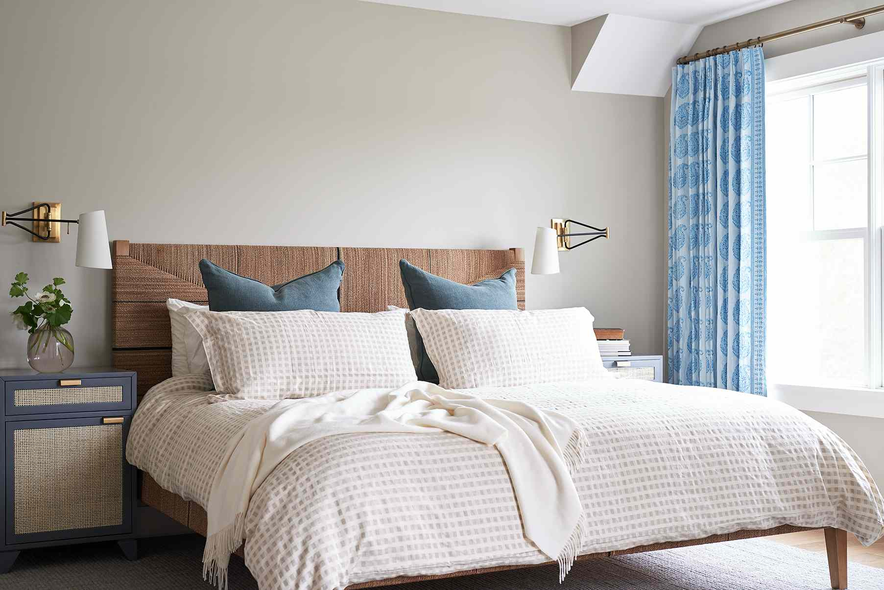 Modern, fresh bedroom with taupe-gray walls and blue and cream accents