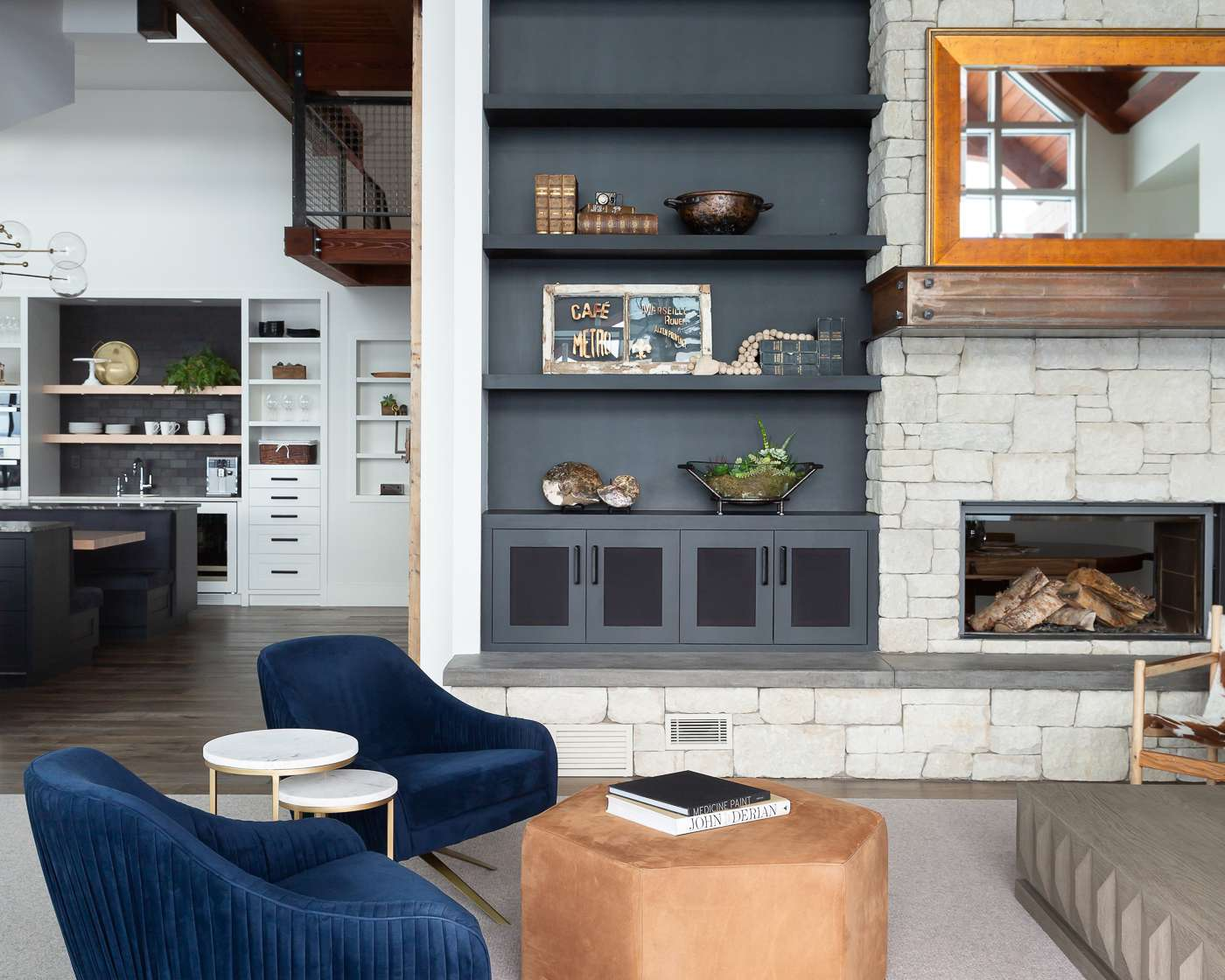 Warm living room with black built-ins.