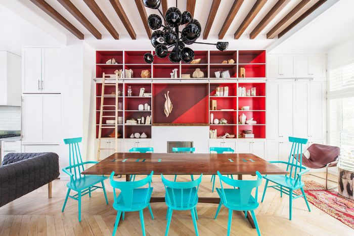 Dining room with turquoise dining chairs