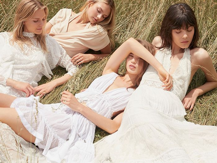 How to reduce stress: women relaxing in a field