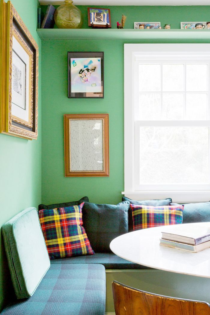 Mix and match frames hang on mint green walls