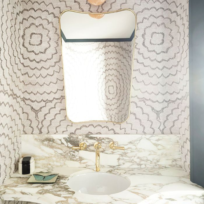 a bathroom with wallpaper with curvy lines