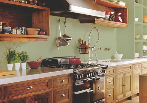 Beautiful wood kitchen with Olive Sprig paint on walls.