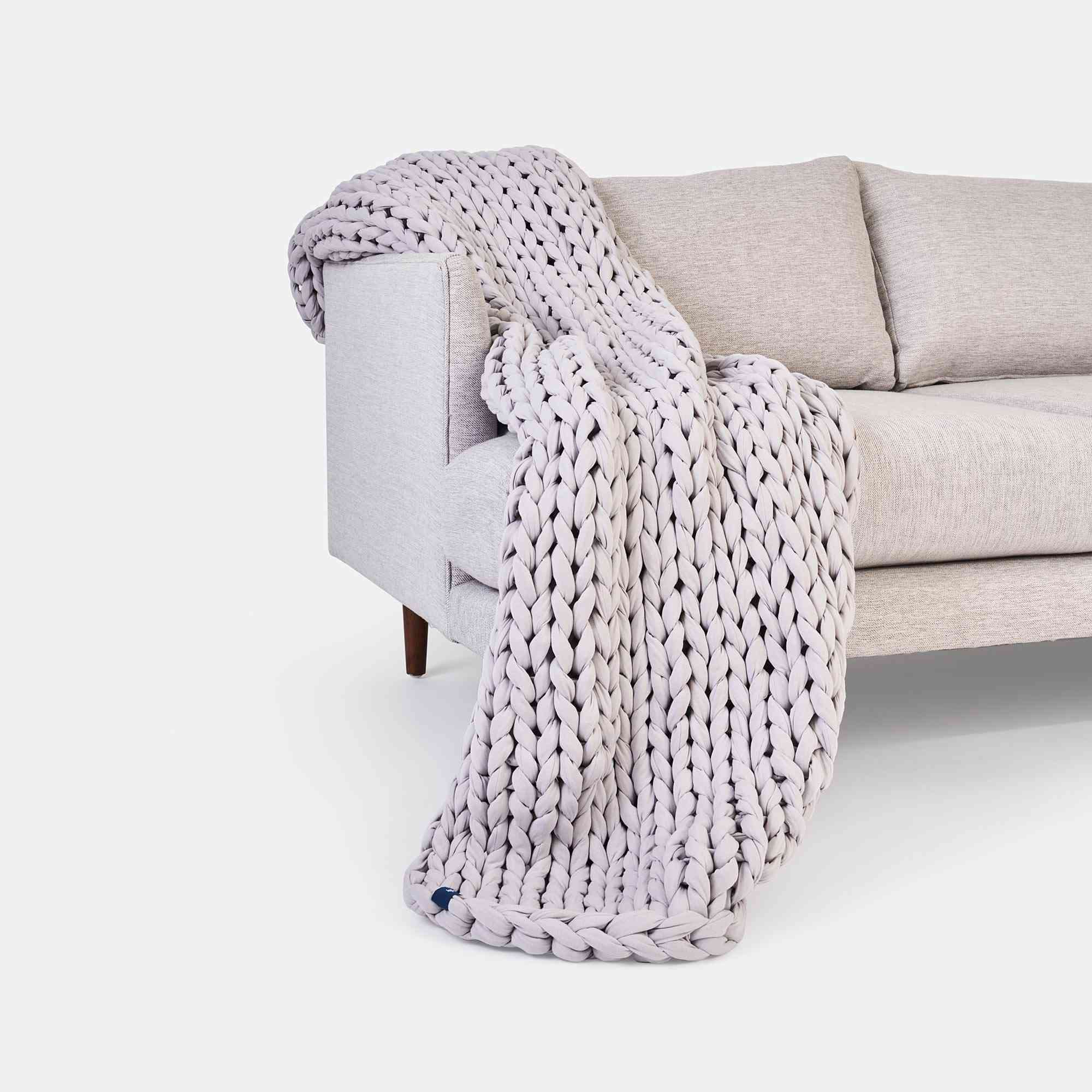 A chunky gray weighted woven cotton throw blanket.