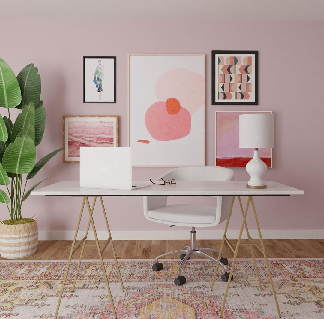 pink home office with gallery wall