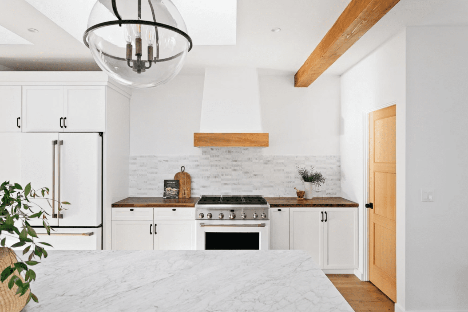 All white kitchen with butcher block counters