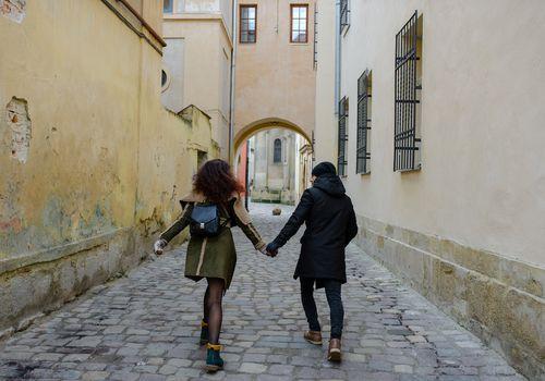 Couple Walking Down Corridor