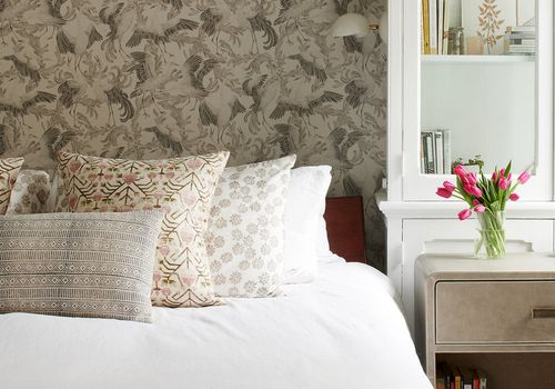 Neutral victorian inspired bedroom with wallpaper.