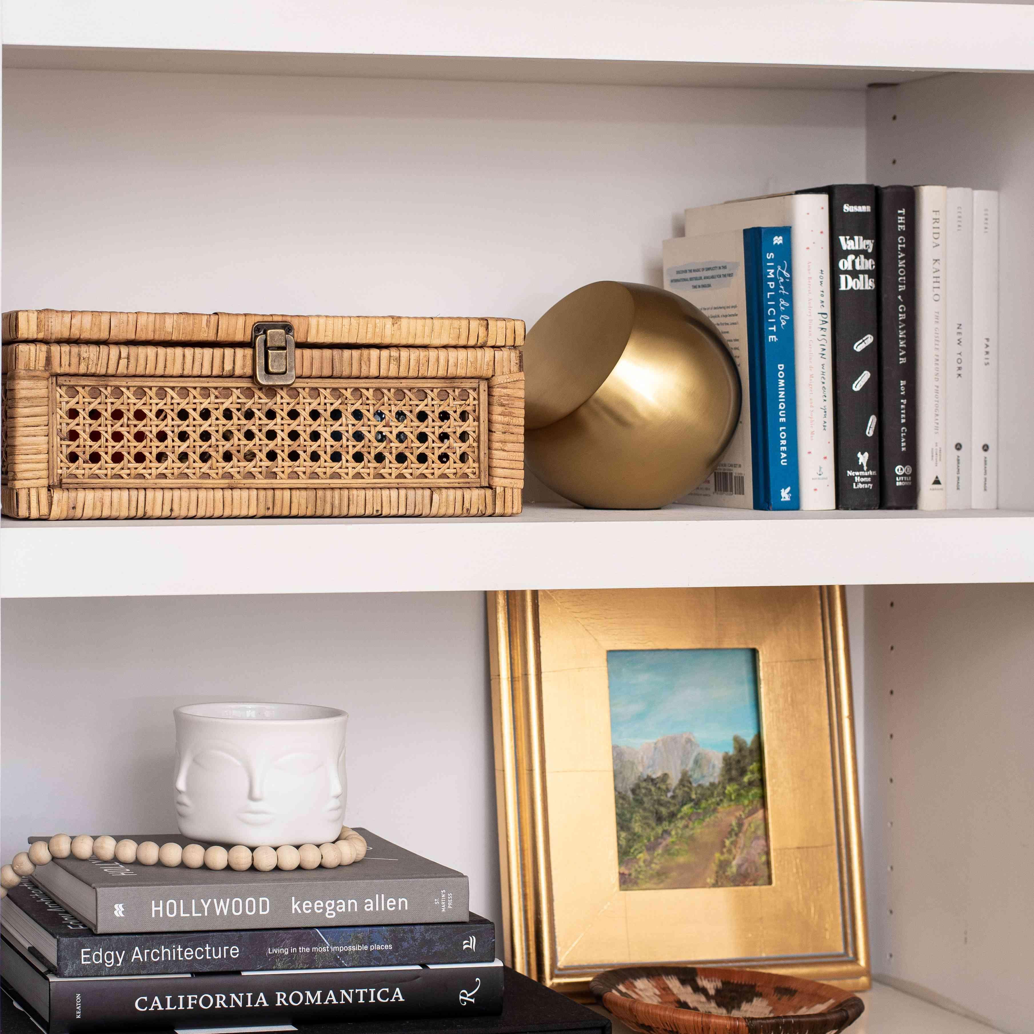Gold decorative objects on shelf.
