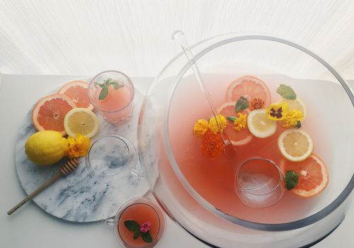 punch bowl with oranges and flowers