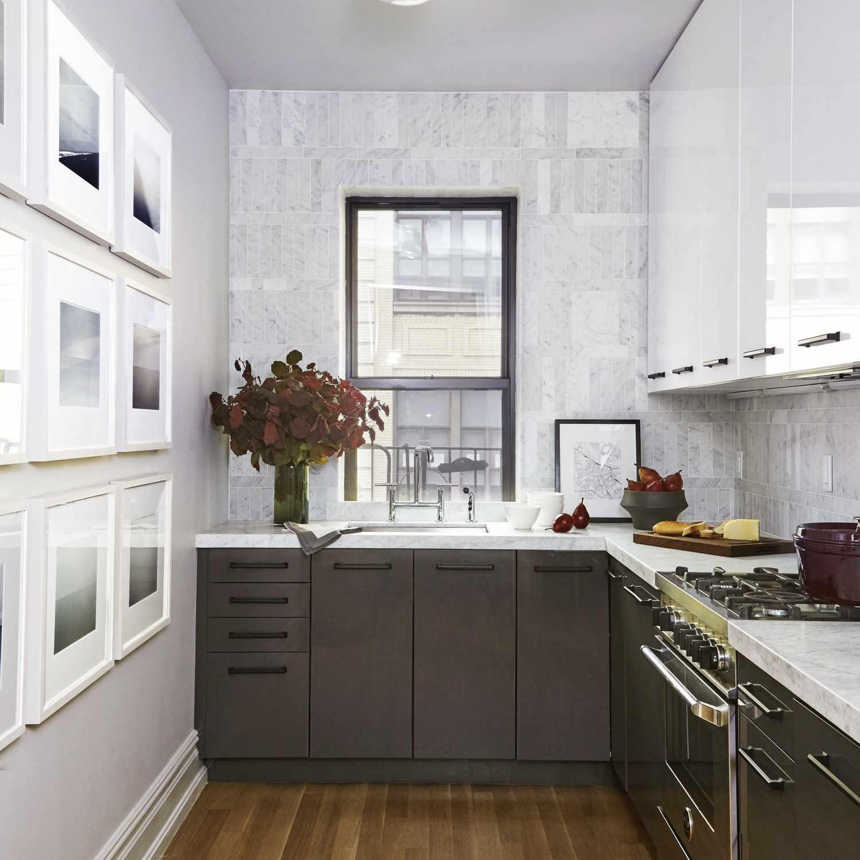 Minimalist kitchen with wall art gallery