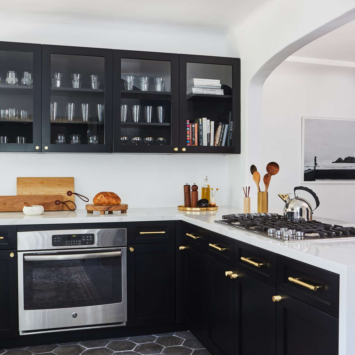An all-black kitchen with matching cabinets and floors