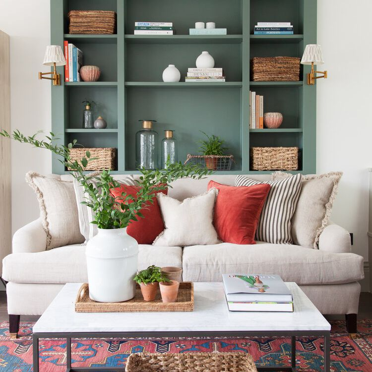 A neat, organized living room with built-in shelves