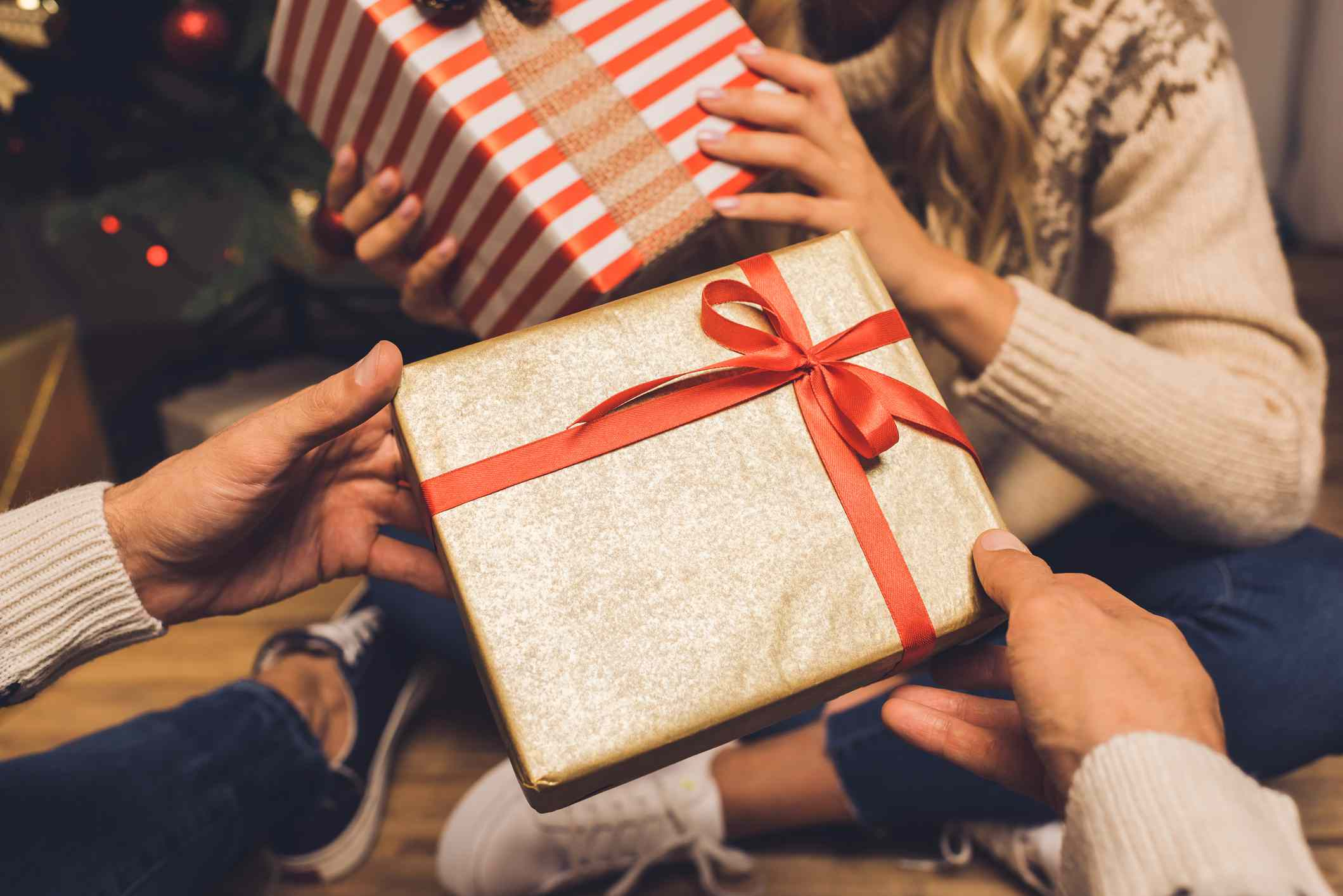 Hands exchange gifts