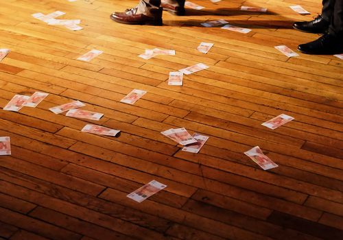 money on the floor at the wedding