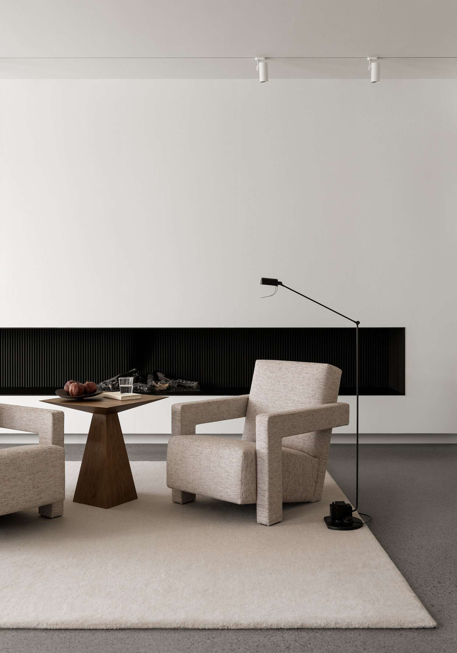 A living room filled with sleek furniture that boasts sleek lines and crisp silhouettes
