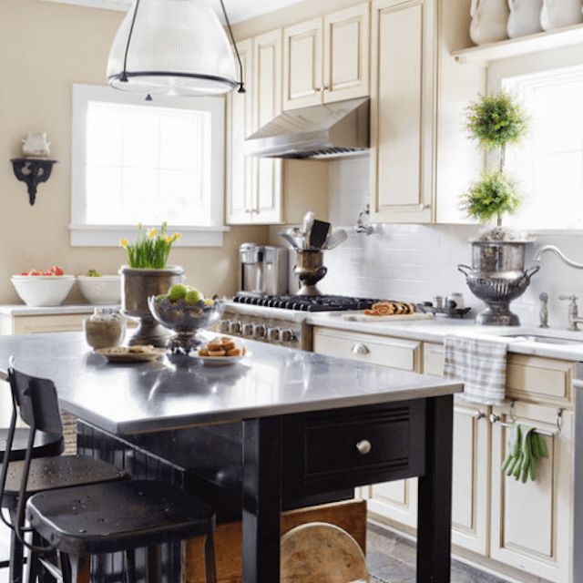 Kitchen island with low shelf for cutting boards