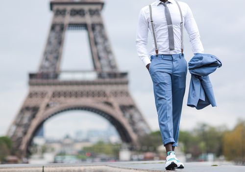 man walking with the Eiffel Tower