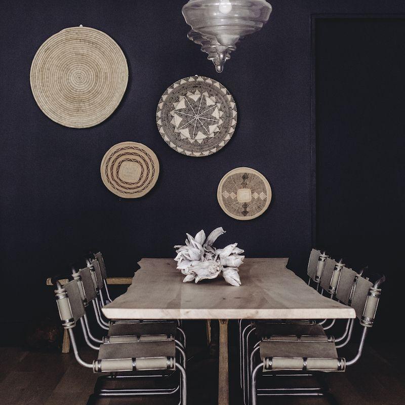 A dining room with dark indigo walls