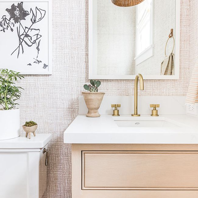 bathroom with pink wallpaper