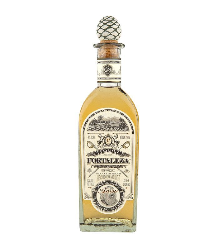 A glass bottle of Tequila Fortaleza Anejo tequila with an agave cork.