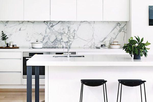 a minimalist, all-white kitchen